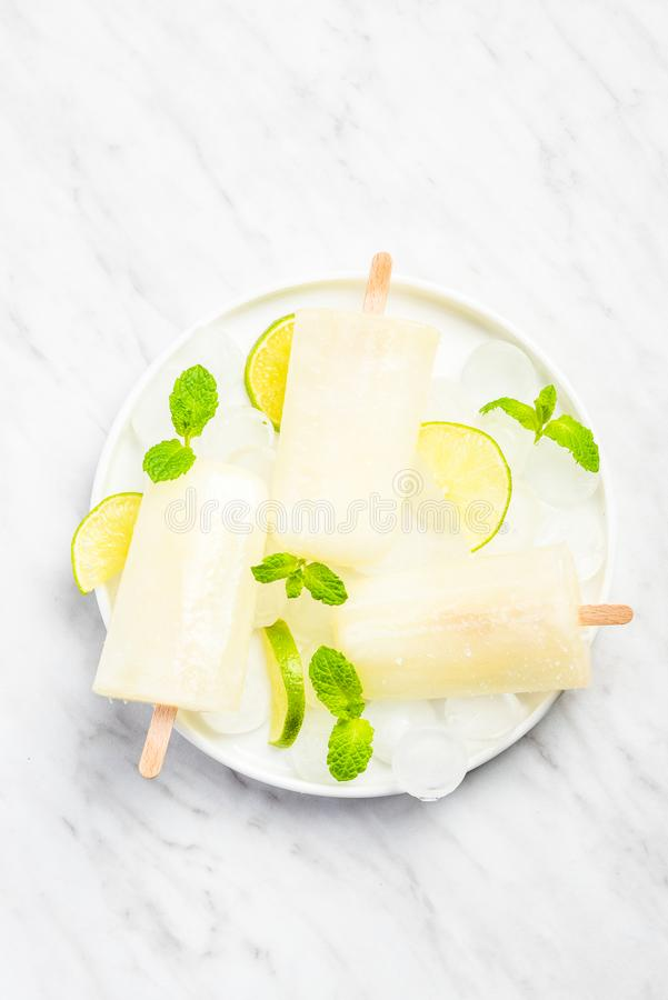 Lemon and lime rrefreshing popsicles. With mint background bright citrus cold colorful concept cool copyspace delicious dessert flat lay flavor flavored food stock photography