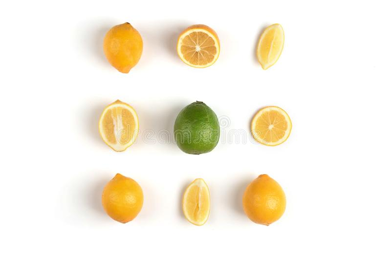 Lemon and  lime on the white background. Fruit mix of lemon and lime on a white background with green leaves stock image