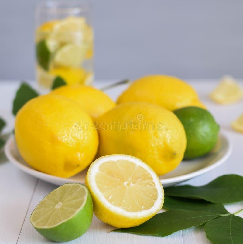 Lemon and lime on the wood table lemonade fresh leaf close up fruits citrus royalty free stock photo