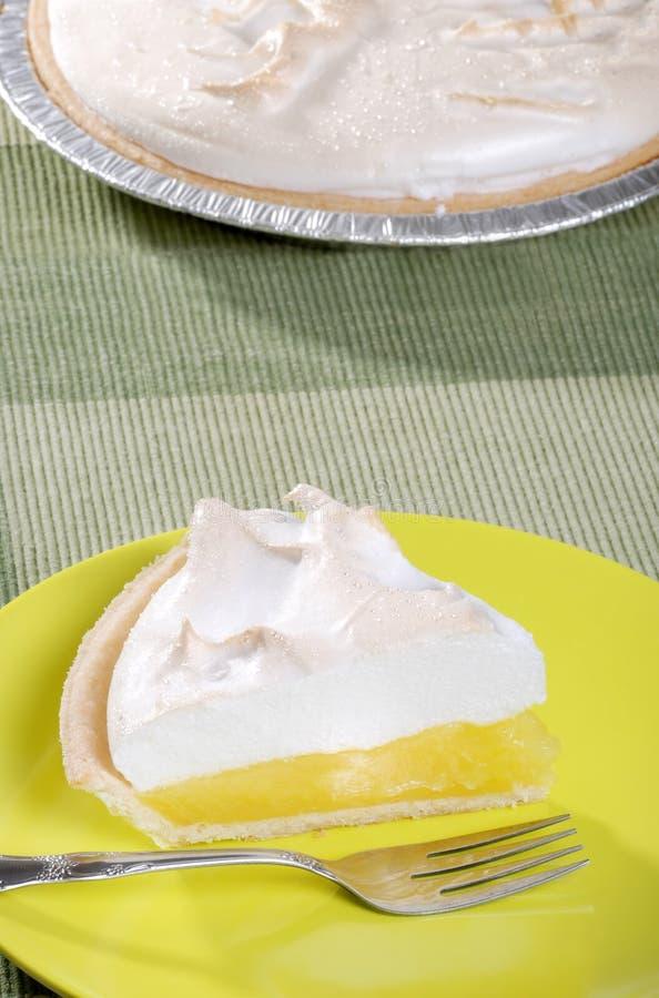 Lemon meringue pie with fork royalty free stock image
