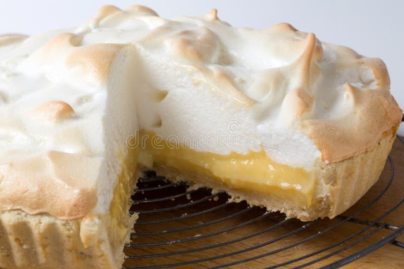 Lemon meringue pie on the rack royalty free stock image