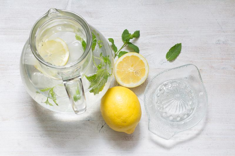 Lemon mint  and water  refreshing cocktail still life. Closeup royalty free stock images