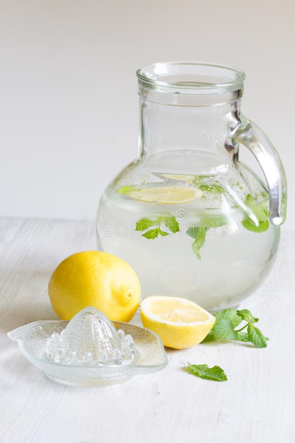 Lemon mint  and water  refreshing cocktail still life. Closeup stock photography