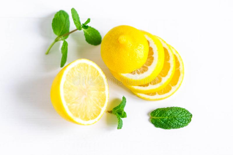Lemon with mint on a white background. Healthy food products. Vitamin C. Beautiful lemon photo. Flat lay, top view. Lemon with mint on a white background royalty free stock image