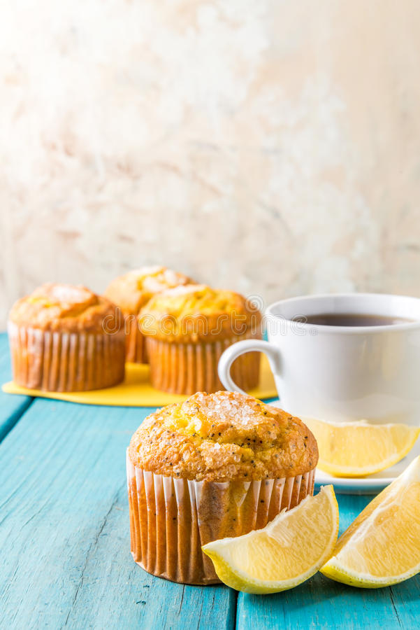 Lemon Muffins with cup of tea / coffee stock photos