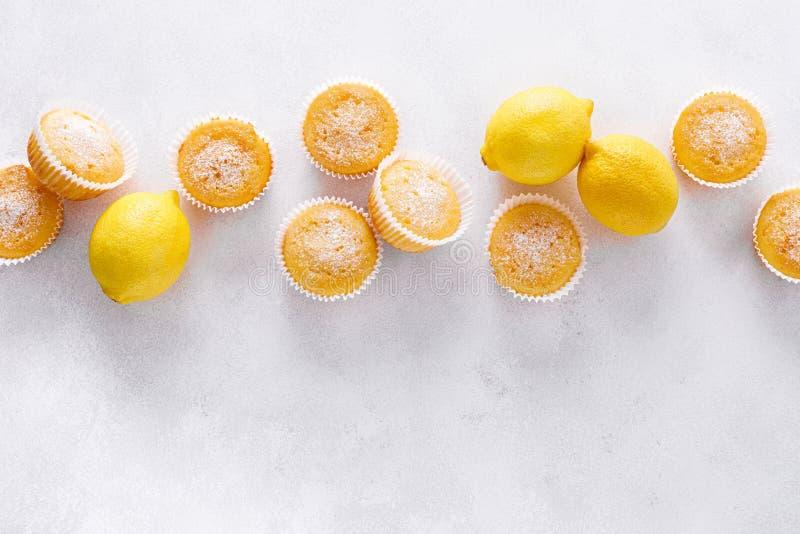 Lemon muffins with sugar powder royalty free stock photos