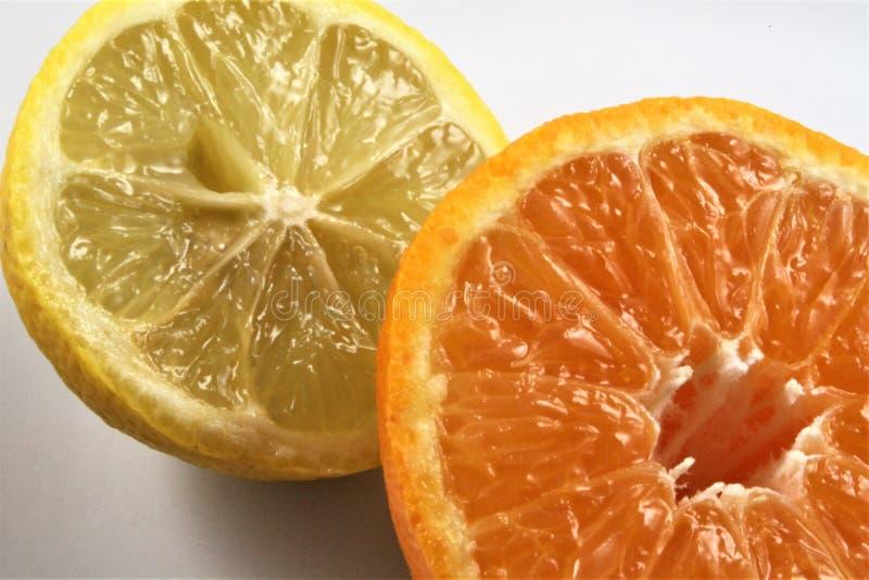 Lemon and orange cut in half royalty free stock photography