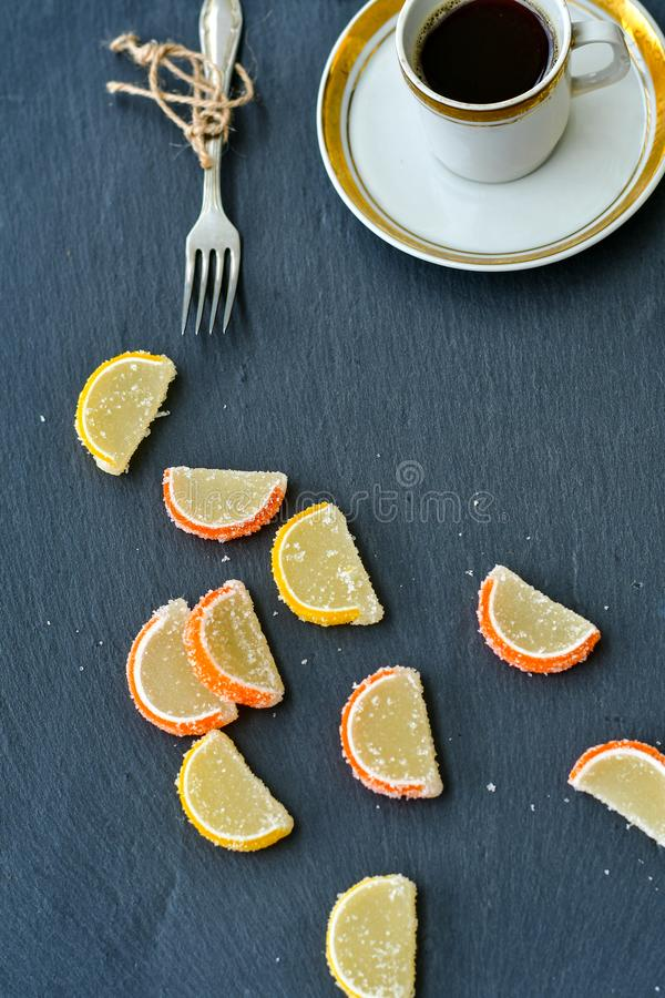 Cup of coffee and lemon slices stock photo
