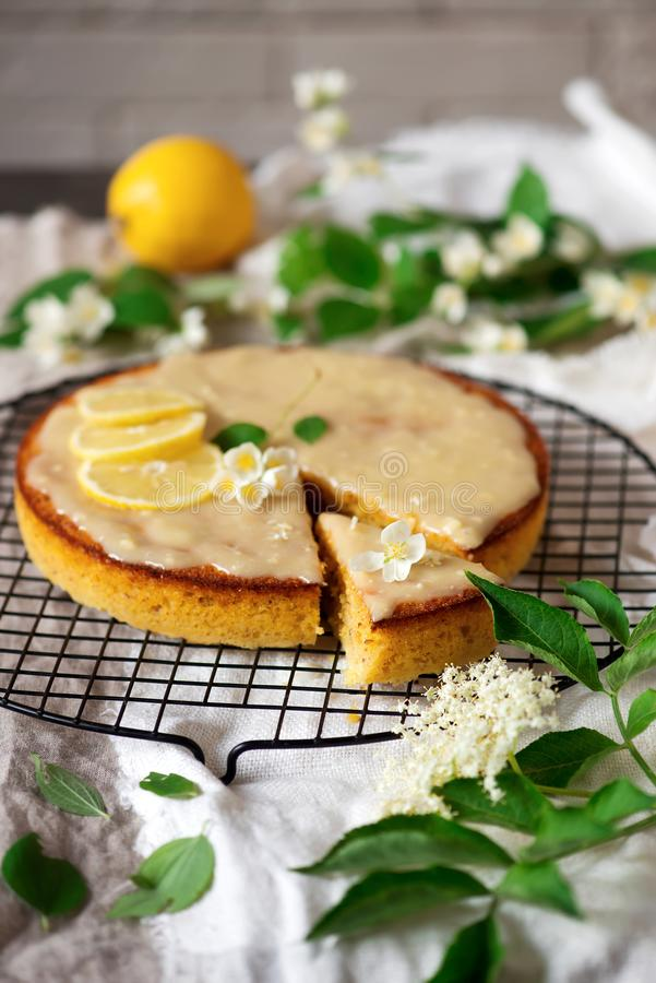 Lemon polenta cake elderflower white chocolate ganache. Vintage style.selective focus stock images