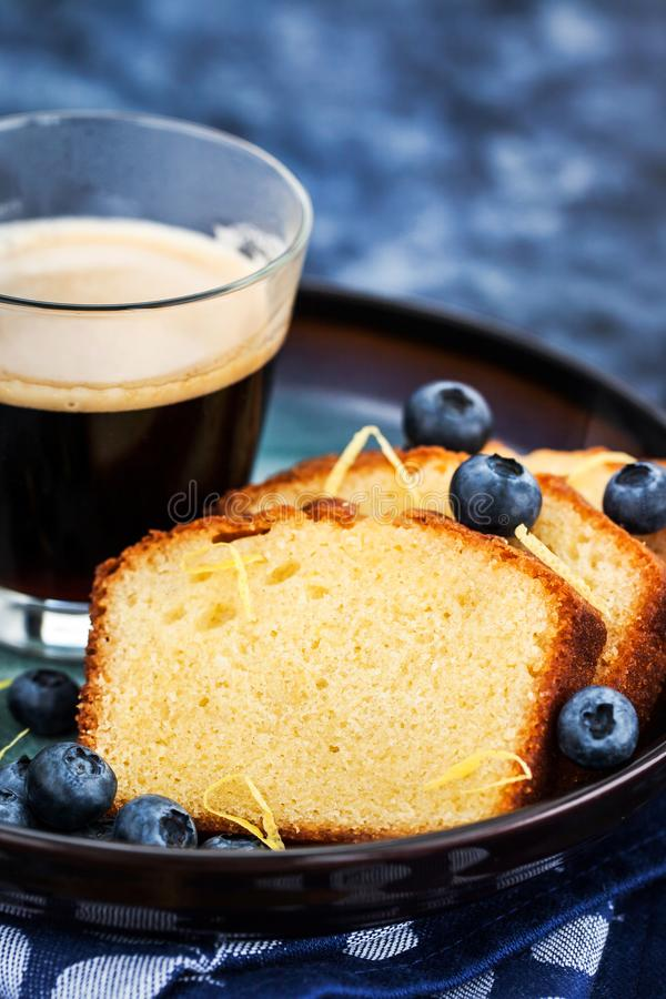 Lemon pound cake slices and cup of coffee stock image
