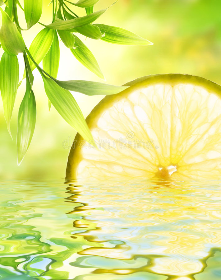 Lemon reflected in water stock photography
