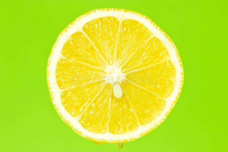 Download Lemon Slice On Green Background Stock Photo - Image: 27036240