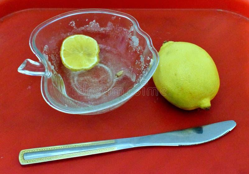 A lemon slice, a lemon and a knife stock photos