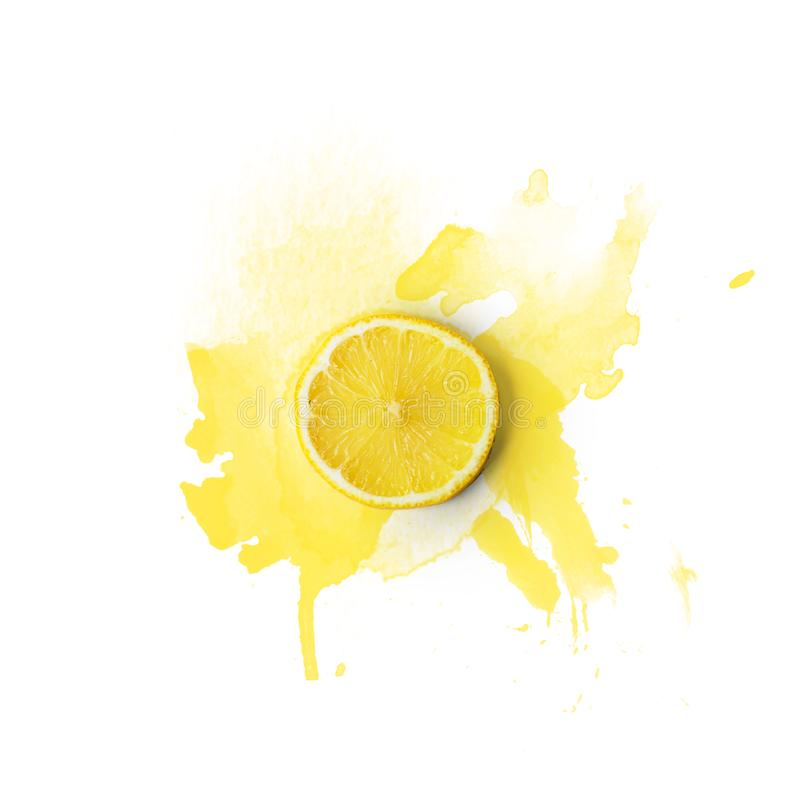Lemon slice on white background with watercolor splashes; Copy s royalty free stock photo