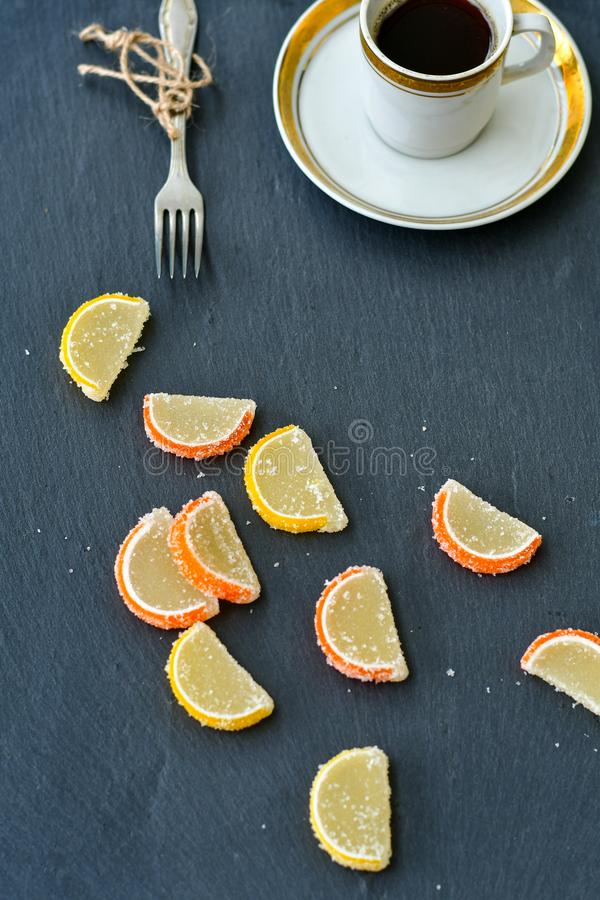 Lemon slices and cup of coffee stock images