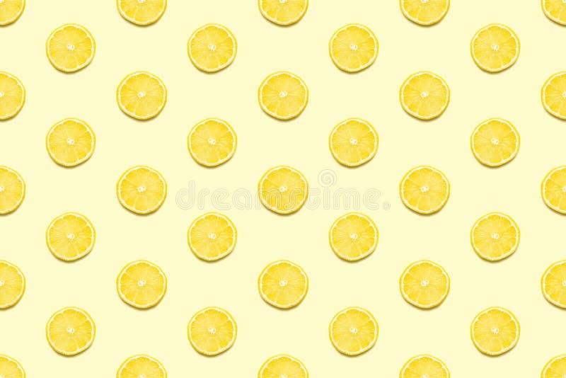 Lemon slices seamless pattern on pastel yellow background Minimal summer concept royalty free stock photos