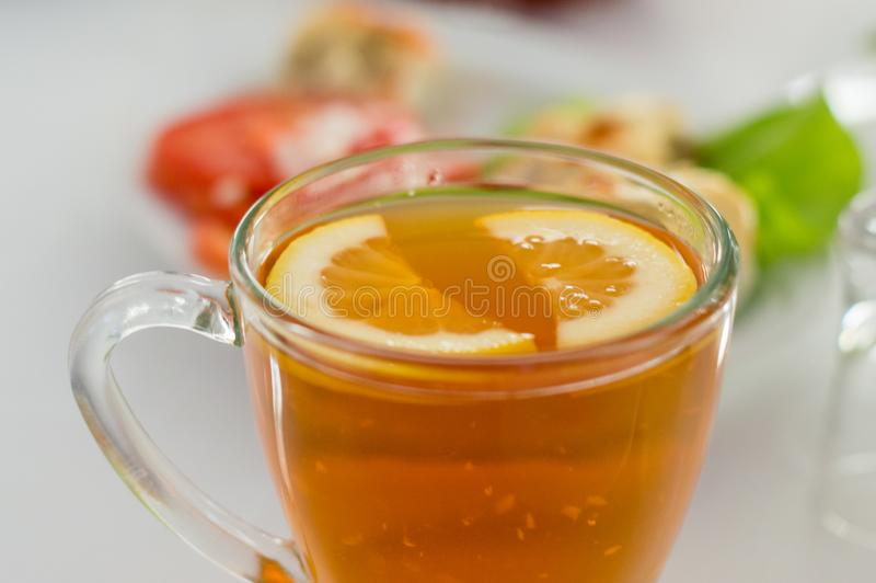 Lemon slices in the tea stock photography