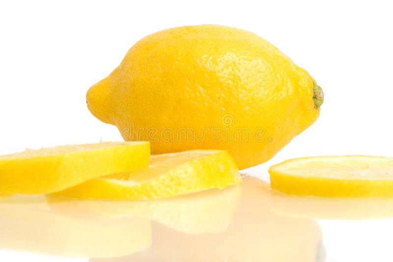 Lemon and Slices on White stock photos