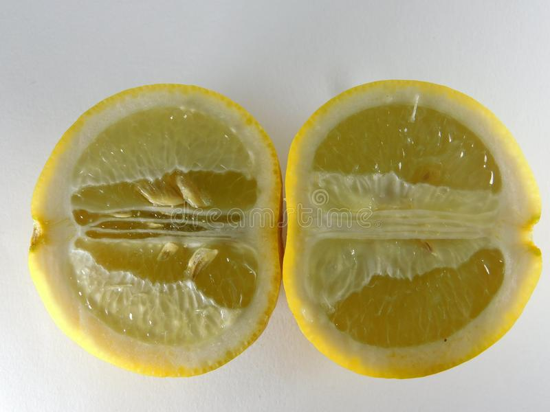Lemon slices on a white background. Food, sour, yellow, seasoning stock image