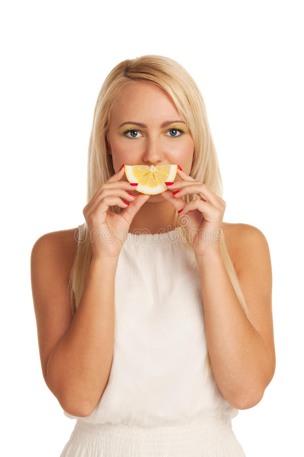 Lemon smile. Girl playing with slice of lemon royalty free stock photo