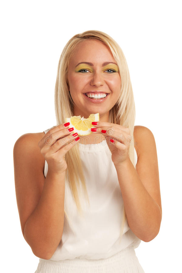 Lemon smile. Smiling girl eating lemon on isolated white background stock photos