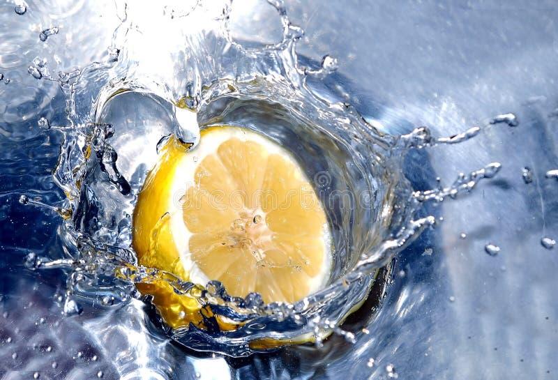 Lemon splashing water royalty free stock image