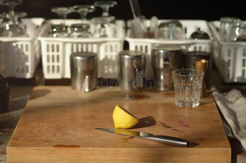 lemon split and knife on Chopping wood behind coffee shop as background royalty free stock images