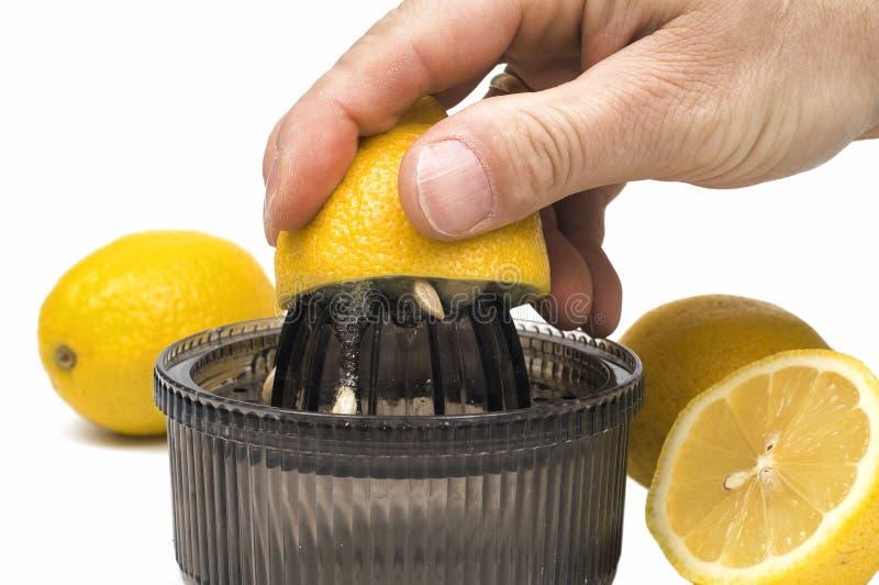 Lemon-squeezer. Presses out lemon fruits isolated on white background stock photography