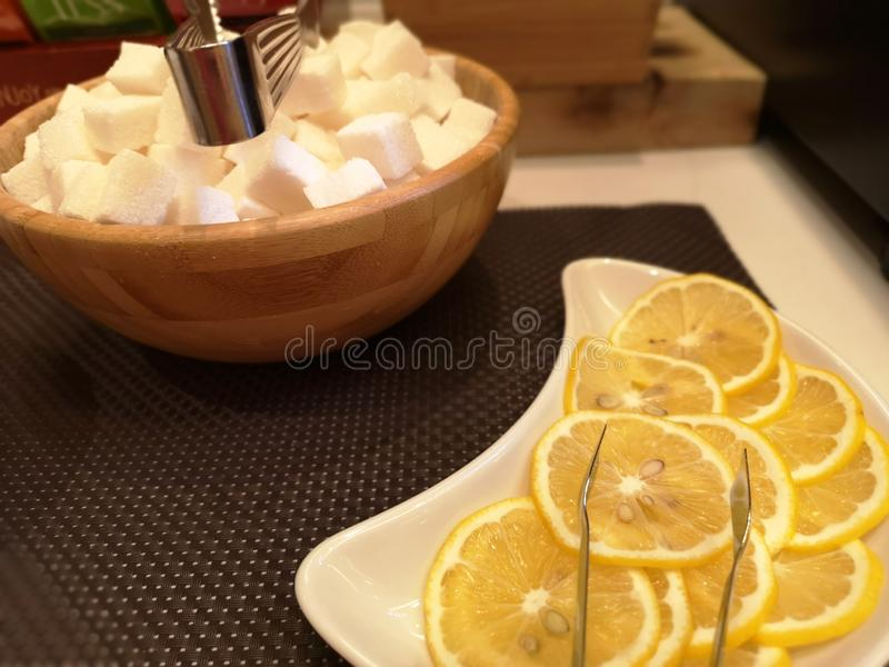 Lemon and sugar cube on the table. Concept breakfast stock photo