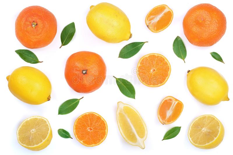 Lemon and tangerine with leaves isolated on white background. Flat lay, top view. Fruit composition.  stock images
