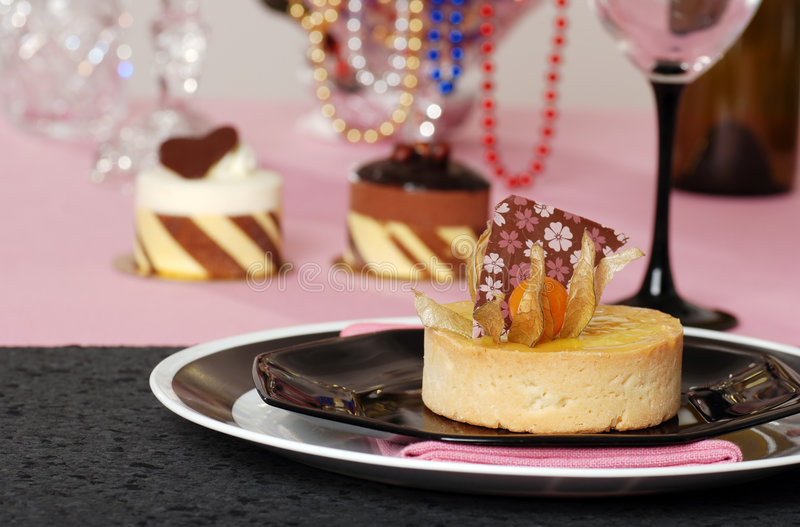 Lemon tart with desserts in the background stock photography