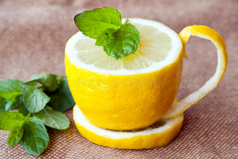 Lemon tea. With a leaf of mint royalty free stock photography