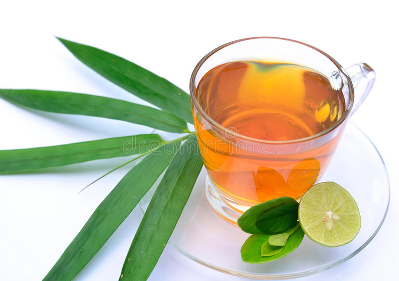 Lemon tea with bamboo leaf. Isolated of lemon tea with lemon and bamboo leaf royalty free stock photography
