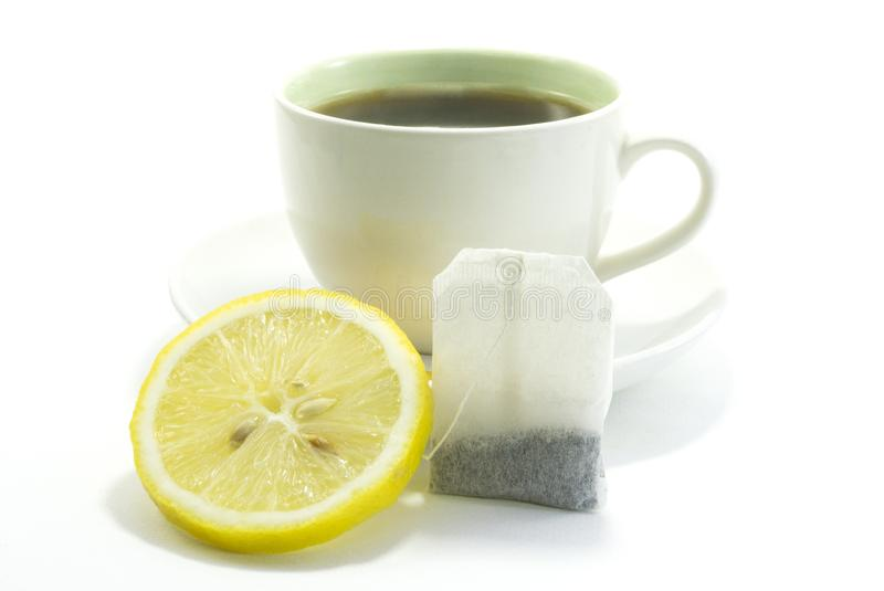 Lemon tea in a hot white glass on white background. stock image