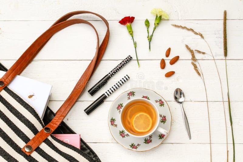 Lemon tea and purse accessories stock image