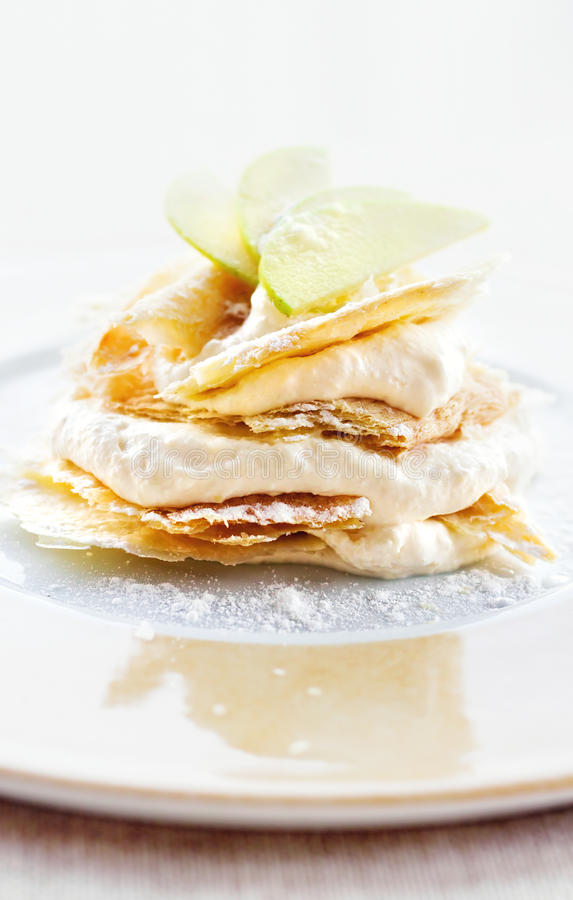 Lemon and vanilla cream cake dessert decorated with apple slices royalty free stock image