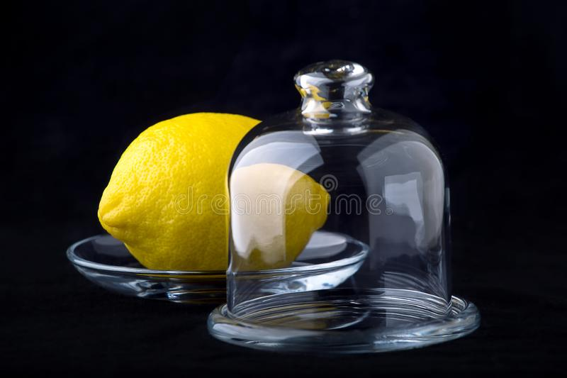 Lemon in a vase royalty free stock photography