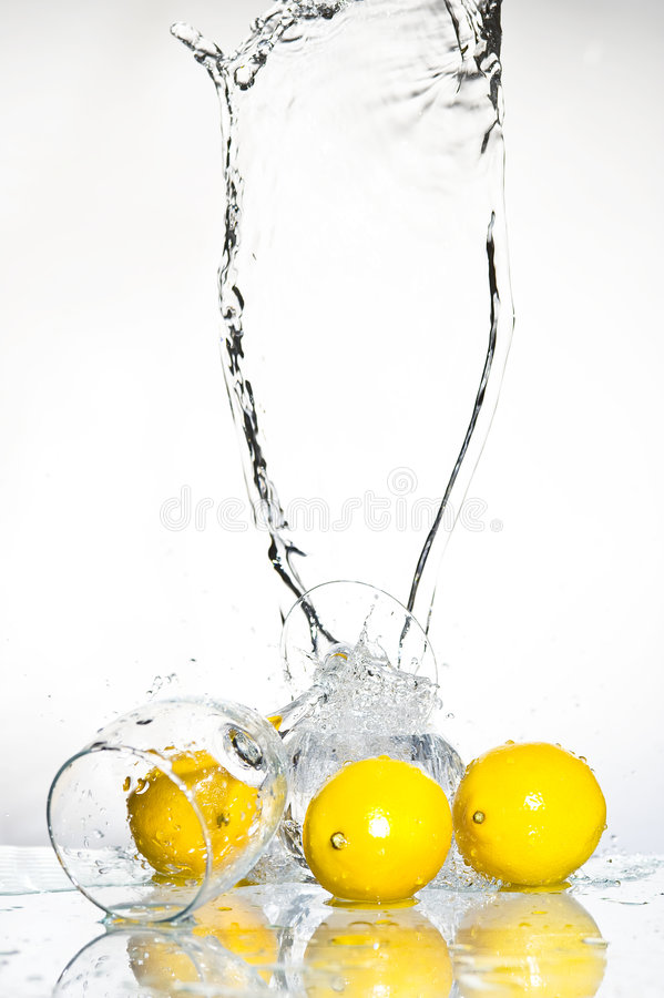 Lemon with water stock image