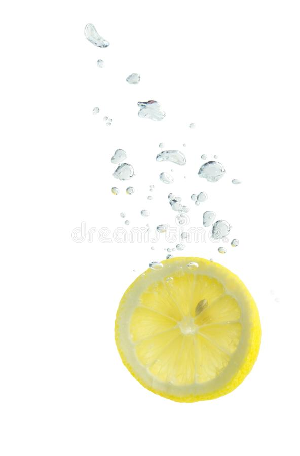 Lemon in water with air bubbles royalty free stock photo