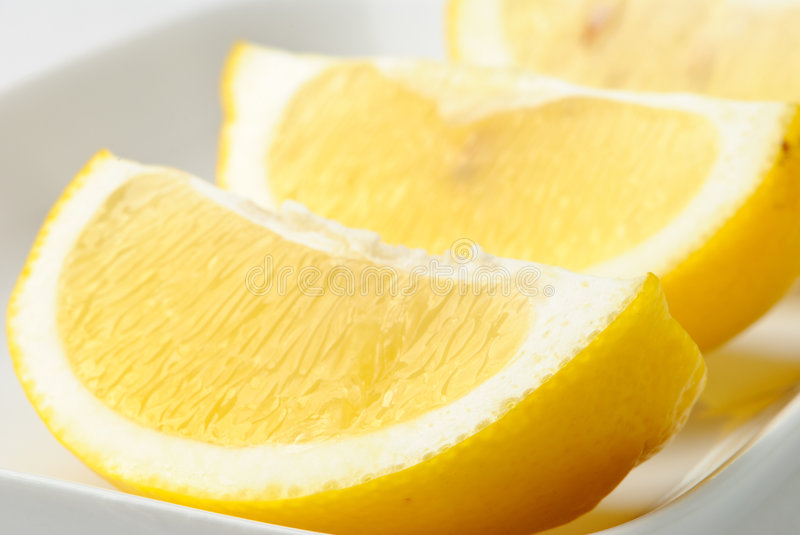 Lemon Wedges. In a white dish royalty free stock photography