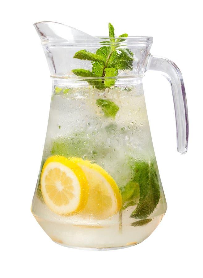 Lemonade beverage on the white background. Fresh cold lemonade beverage with mint on the white background. Isolated stock photography