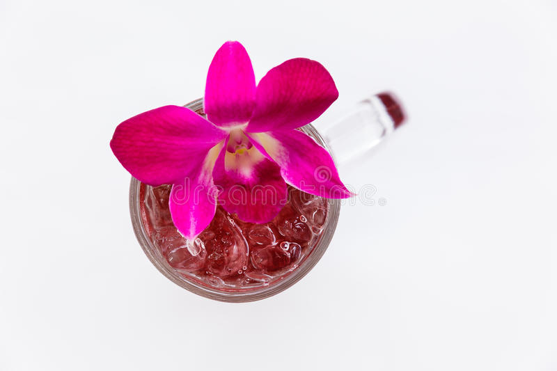 Lemonade with Butterfly Pea Water Decorated with Purple Orchid.  stock image