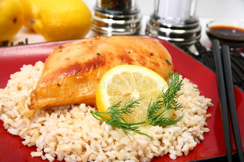 Lemonade Chicken on Brown Rice royalty free stock images