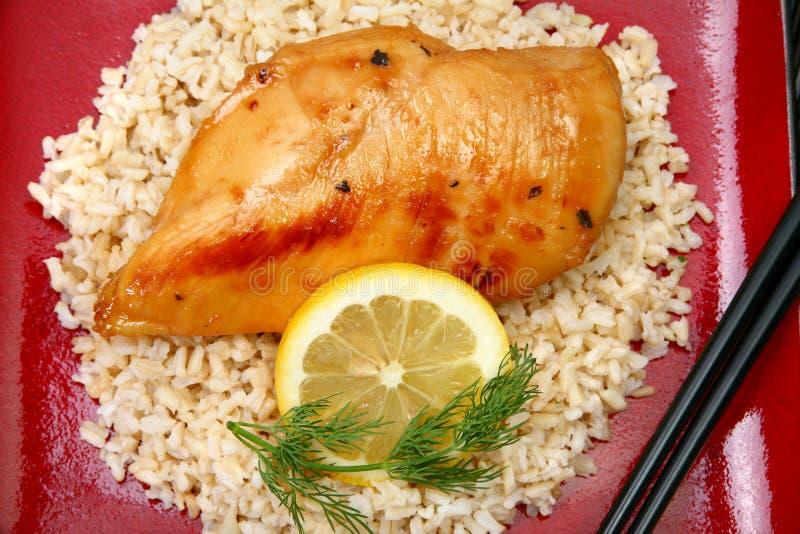 Download Lemonade Chicken On Brown Rice Stock Photo - Image: 4892972