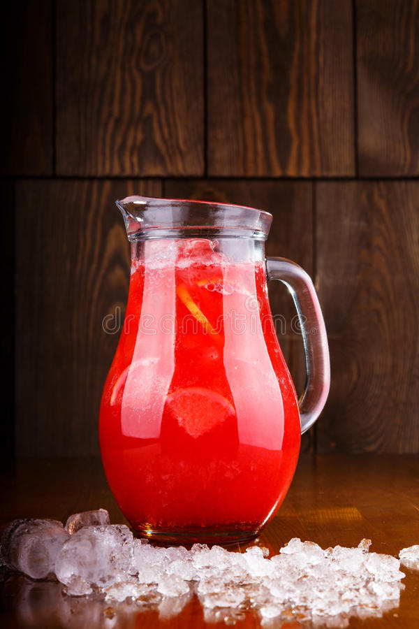 Lemonade drink of soda water. Cold drinks. Summer drink with ice, fresh berries royalty free stock images
