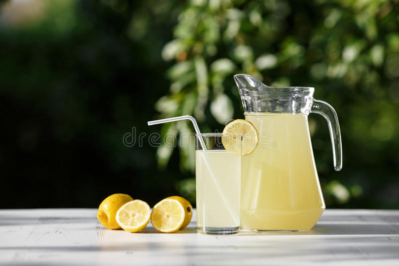 Lemonade. Drink on wooden table in the garden stock photos