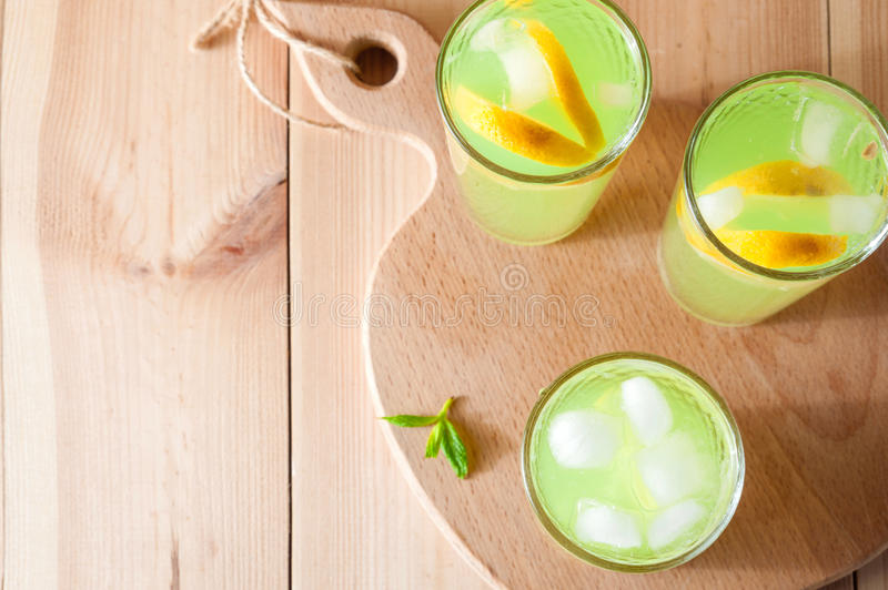 Lemonade glasses with lemon, mint and ice. Top view with copy space royalty free stock image