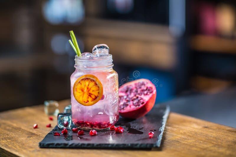 Lemonade. Lemonade vith fresh fruit pomegranate on barcounter in royalty free stock images