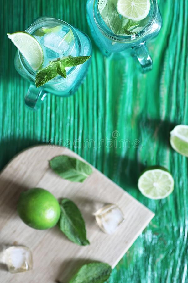 Lemonade from lime and mint. In a glass jar on a tabler stock photography