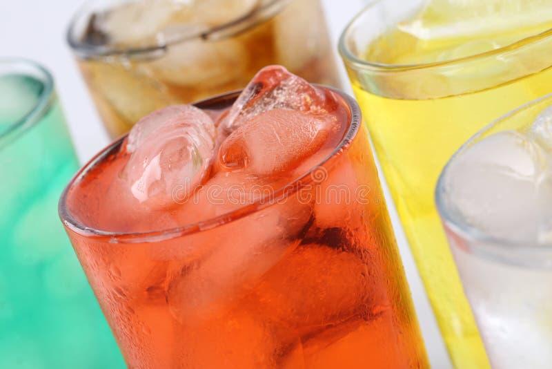 Lemonade soda drinks in glasses. Colorful lemonade soda drinks, soft drinks in glasses with ice cubes stock photo